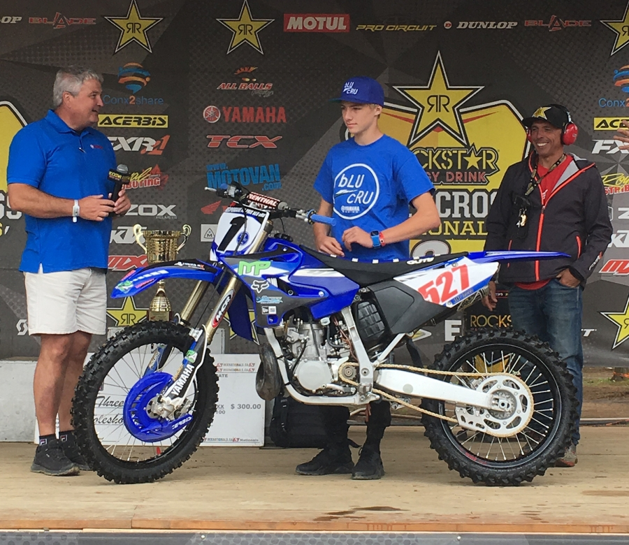Jake Tricco (centre) accepts the 2017 Eastern bLU cRU Factory Ride Award at Deschambault from Yamaha Motor Canada's Francois Morneau (left) last August. Josh Gedak (not pictured) was the second winner in 2017.