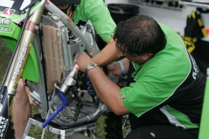 Ed Gardner works on Evan Laughridge's Kawasaki